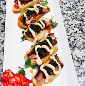 The guests were served yummy flank steak crostini bites
