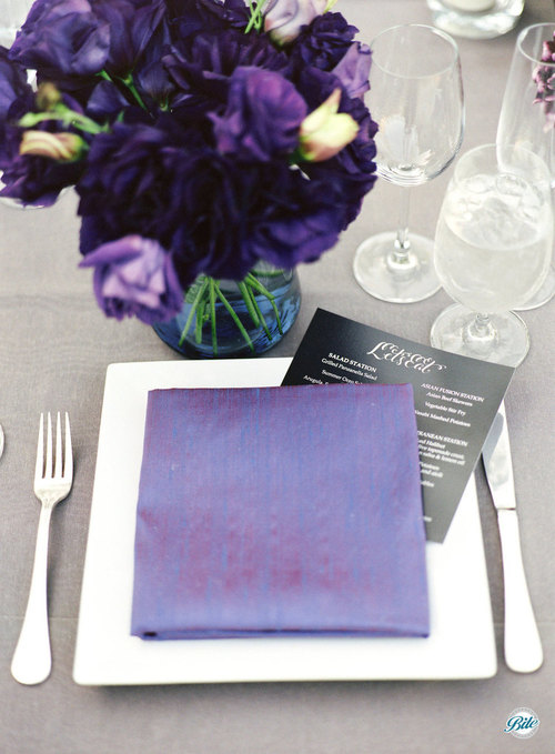 Place setting with individual customized wedding and the brides favorite shades of purple