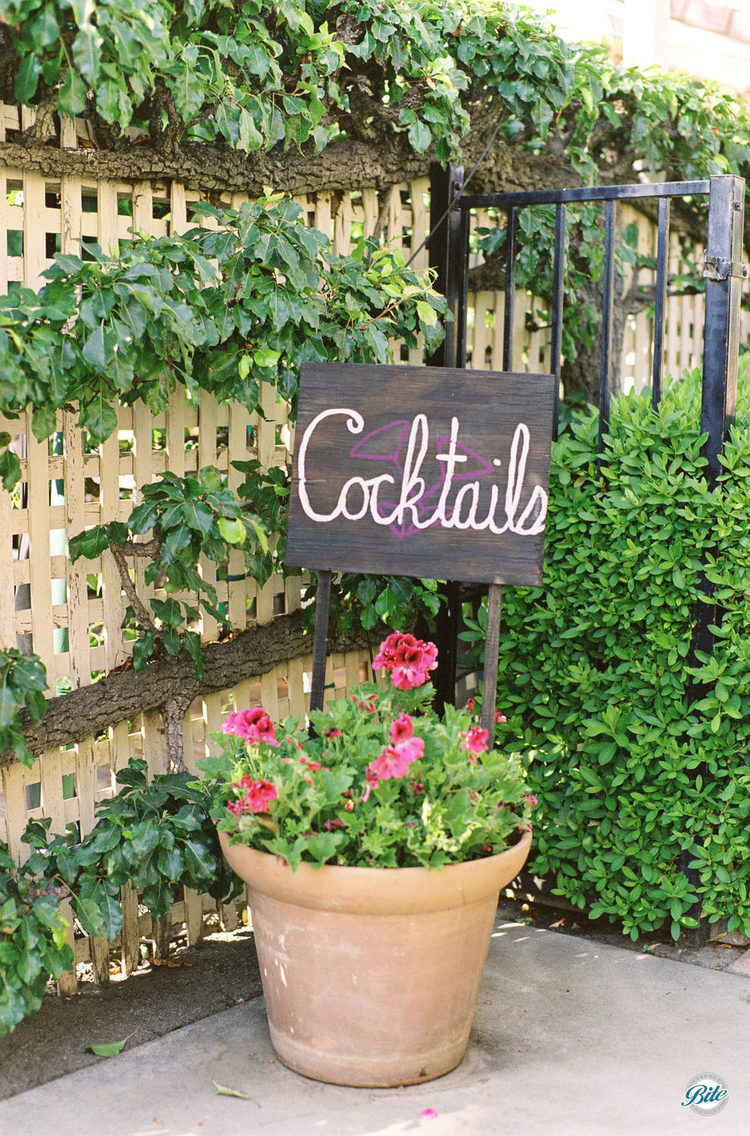 Adorable custom made signage for cocktail hour!