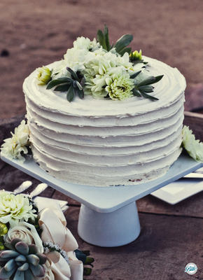 A Rustic Wedding Cake with White Buttercream, Flowers and Succulents