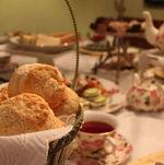 Scones in Basket on Table with Classic Tea Service