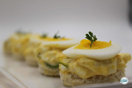 Egg Salad Tea Sandwich with sliced egg on top from Bite Catering's Full-Service High Tea menu