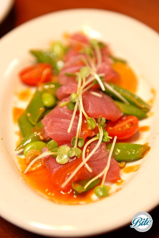 Ahi Tuna Sashimi with Edamame, Blue Lake Green Beans, Sugar Snap Peas, Cherry Tomatoes, daikon sprouts and sriracha vinaigrette