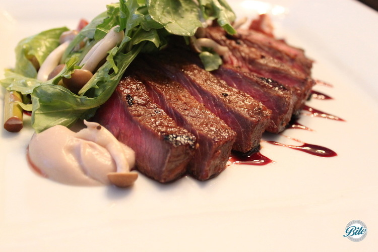 New York strip steak with cauliflower puree, red wine reduction, citrus salad, and enoki mushrooms