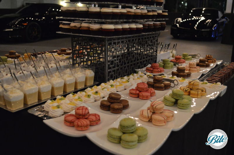 Dessert station with logo cupcakes,