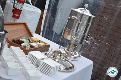 Coffee and Tea Service at the end of a buffet with metal urns and a selection of teas.