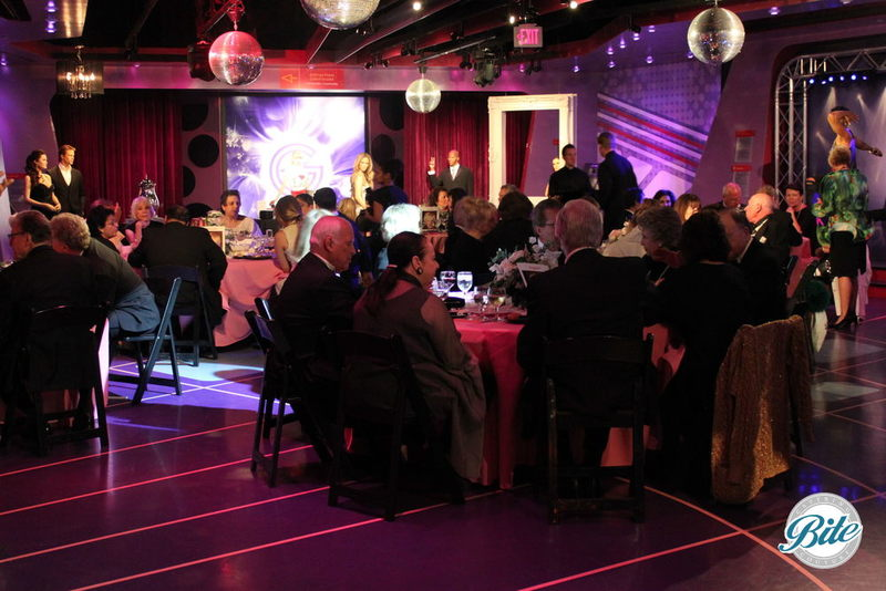 Guests sitting down to dinner in party room at Madame Tussauds