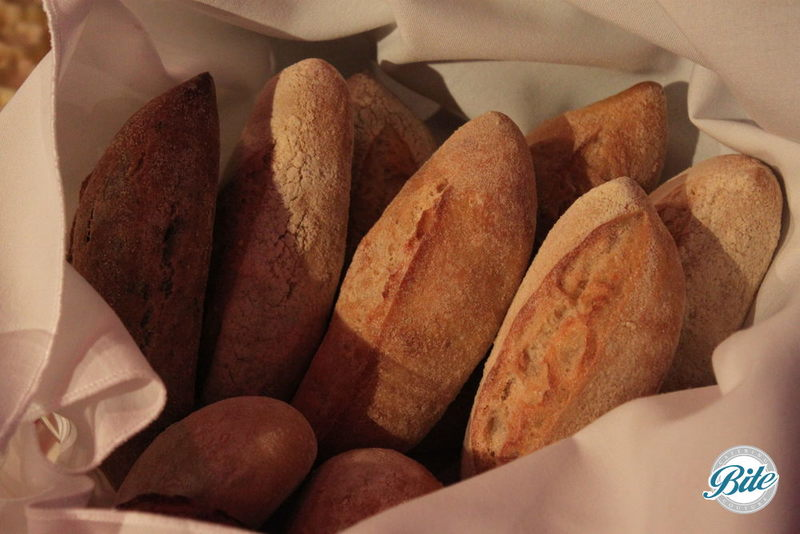 Hot artisan bread fresh to the table ready for some flavored butter