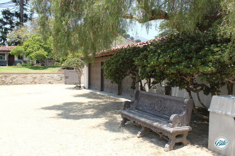 3 car garage and a decorative carved bench outside the Adamson House