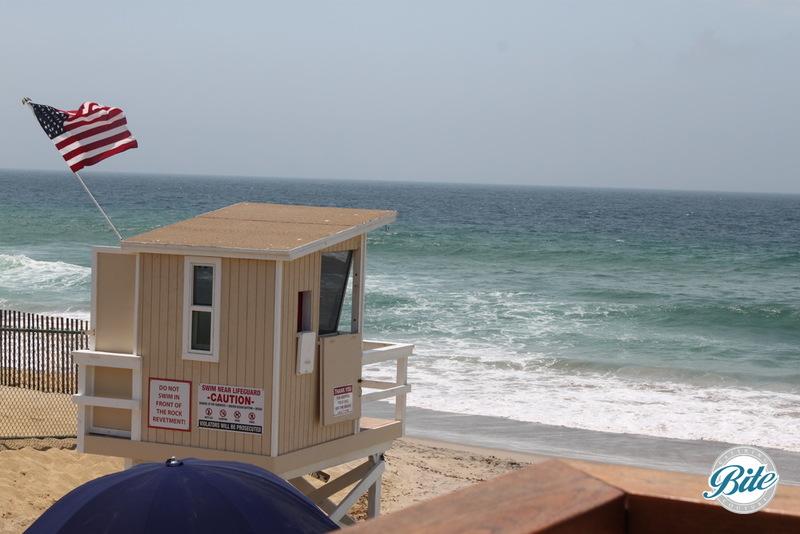 Lifeguard tower immediately off the deck. Private beach immediately below Malibu West Beach Club