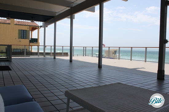 View of the large deck space available for ceremonies overlooking the water @ the Malibu West Beach Club