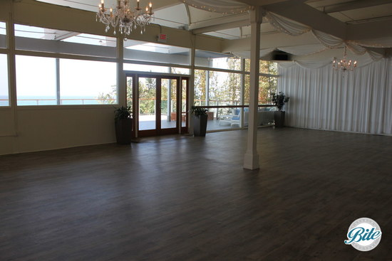 Large windows and glass doors create an open, airy feel and bring in lots of light @ Malibu West Beach Club