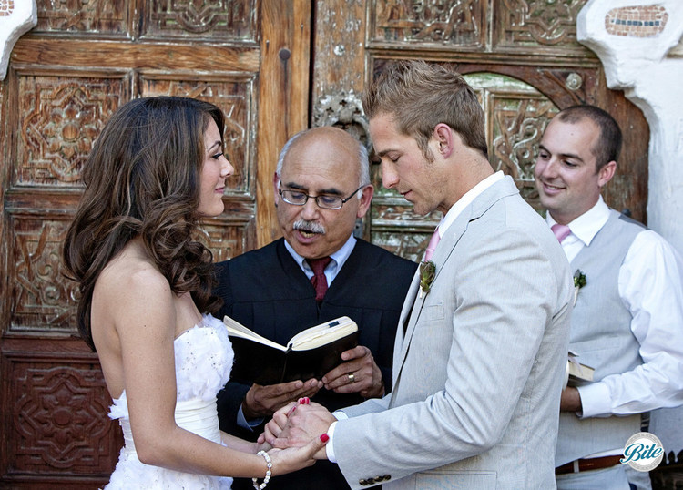 Couple during wedding ceremony, exchanging vows
