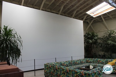 Cinema lounge's giant screen provides background images during an event or can be made the center of attention for film screening or corporate presentations