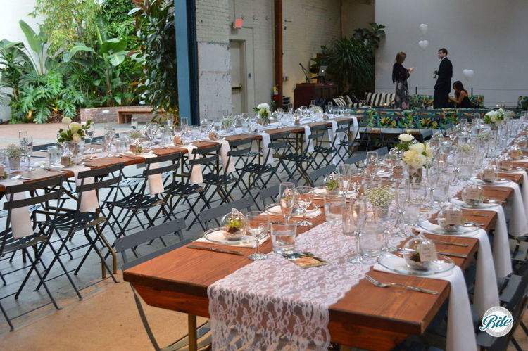 Long tables at Millwick set up for a wedding reception dinner