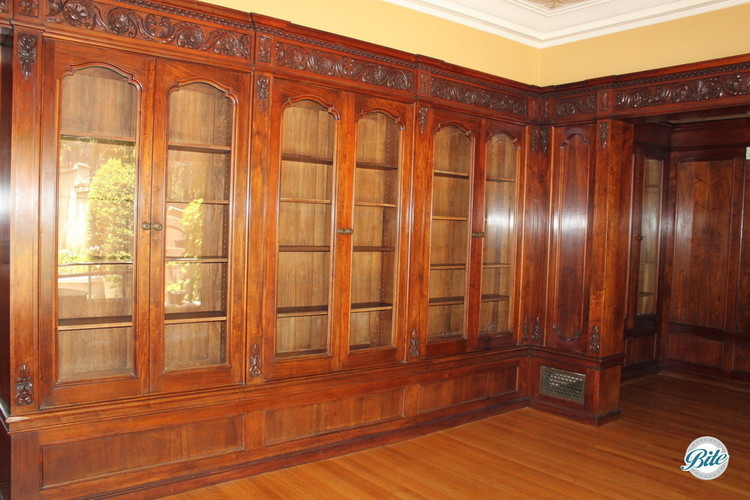 Library at the Wattles Mansion has exquisite wooden bookcases with ornate carvings
