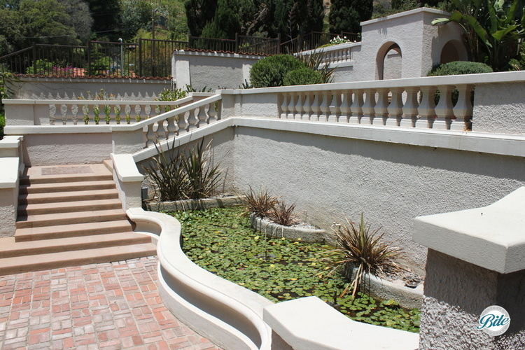 Ornate Hollywood staircase leading to the upper gardens at the Wattles Mansion