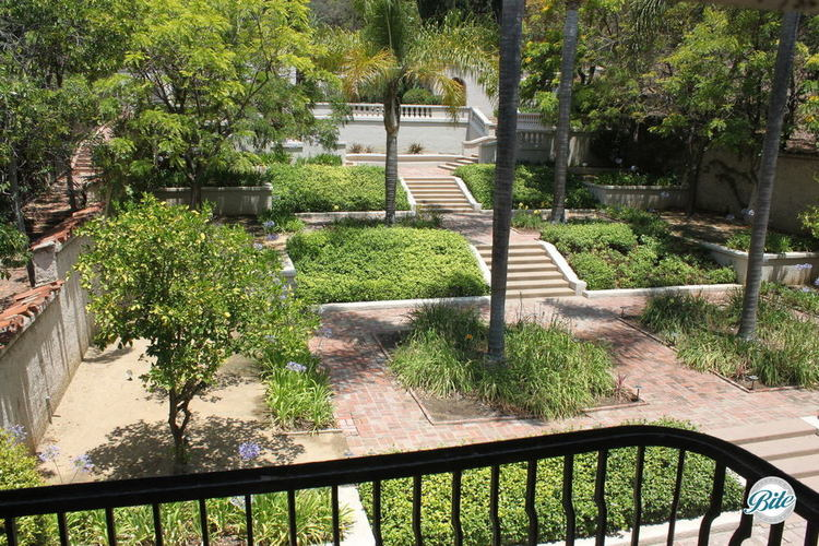 Overview of the gardens in the Wattles Mansion backyard from the second floor