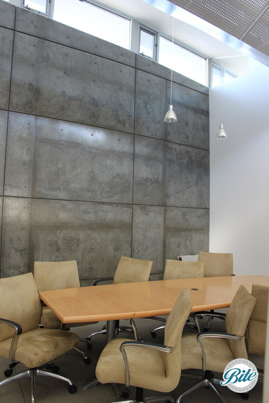 The conference room is a great place to hold an executive offsite discussion with a large table, picturesque settings, and lots of wall space for brainstorming/ notes