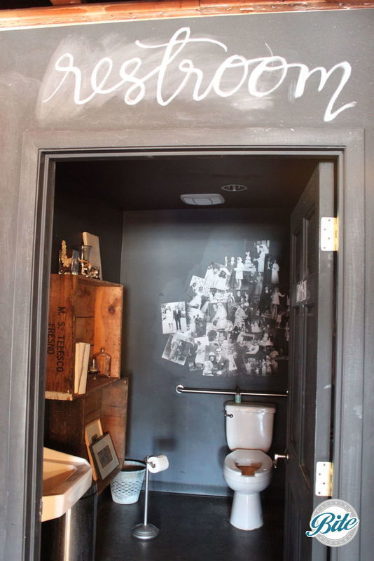 Anything but your boring standard restroom, with colorful chalk areas to customize and fun photographic elements inside