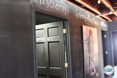 Area outside the restrooms @ Smoky Hollow Studios is a creative space that can be decorated with art and chalk!