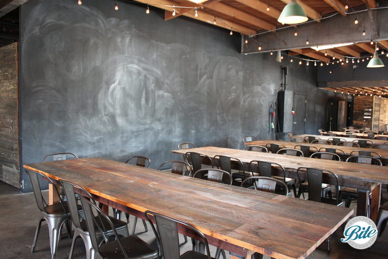 Rustic wood tables and large chalkboards create a flexible rustic setting with lots of creative space