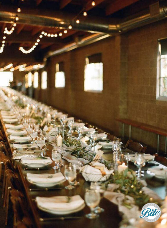 Wooden table set for service. Highlights the rustic tables that are available with the space rental