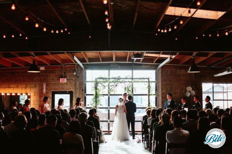 Wedding ceremony in the front of Smoky Hollow Studios space.