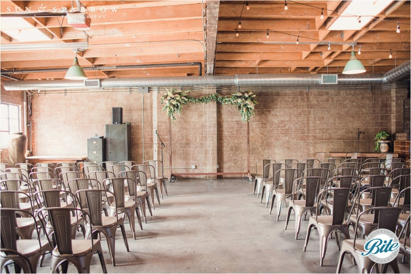 Alternate positioning of altar for ceremonies against the brick backdrop in the front of the studio space