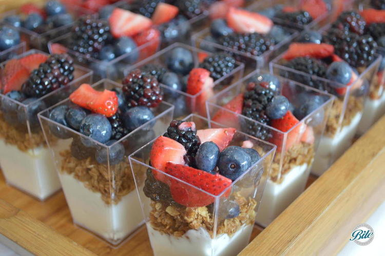 Granola Parfait with greek yogurt, honey, homemade granola, fresh blueberries and strawberries. Packaged in clear cups