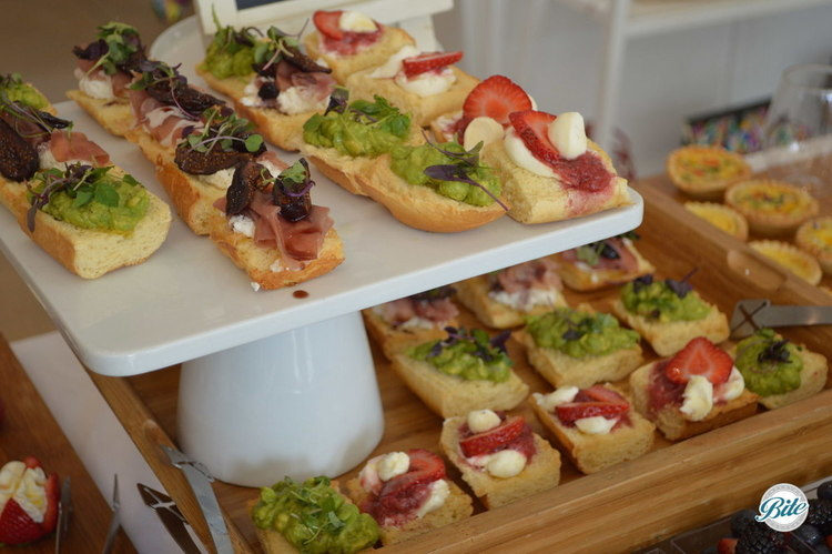 Assorted tartines including avocado toast, strawberry/mascarpone/honey and prosciutto with ricotta, fig and greens