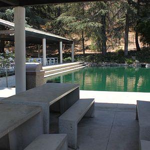 Adjacent Tables and Pond @ Grace Simons Lodge