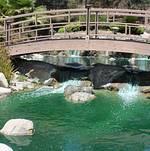 Closeup of bridge over the flowing brook @ Grace Simons Lodge