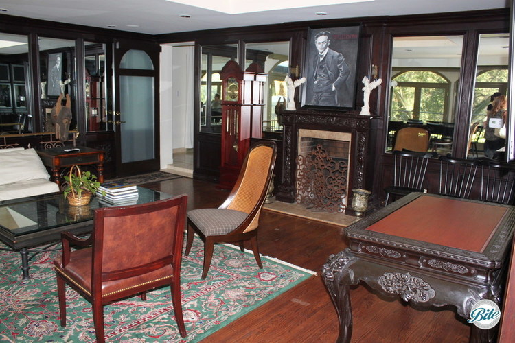 Parlor on the inside of the residence with a namesake portrait above the fireplace