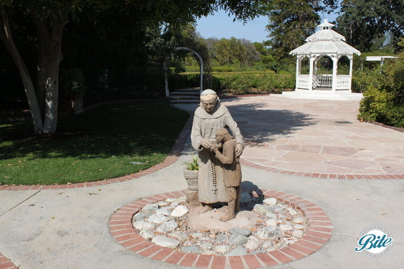 Statue of nun with gazebo in background