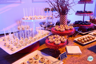 Dessert table decorated with holiday cheer. Snowman cake pops, pumpkin pie bites, key lime pie bites w/ graham cracker cup, chocolate peppermint bars