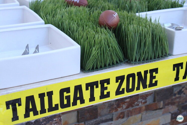 Yellow caution tape depicts the Tailgate Zone!
