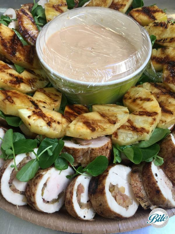 All Spice Jamaican style baked chicken breast, grilled sriracha pineapple and zesty watercress. On delivery platter.