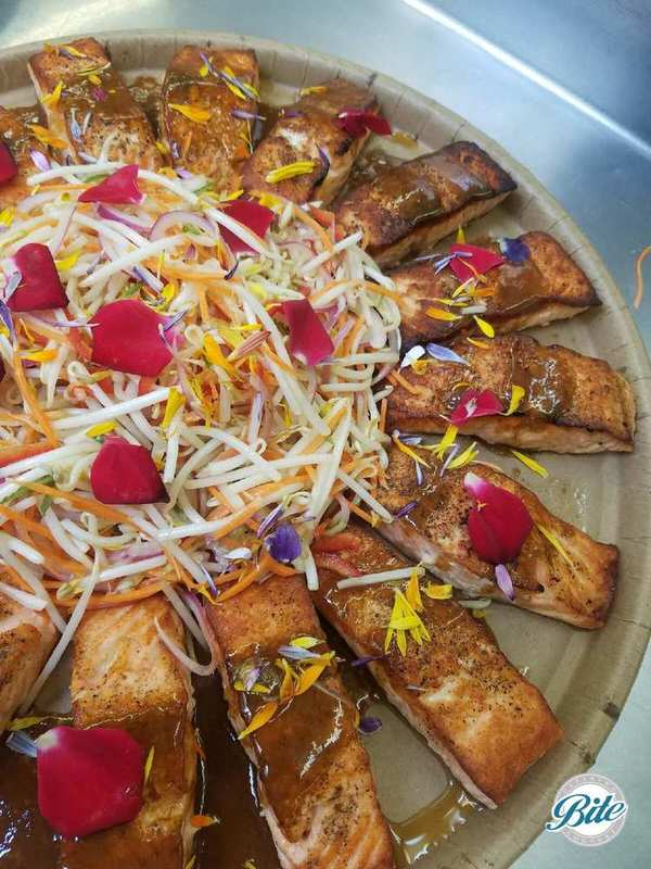 Seared Salmon with ponzu sauce and marinated bean sprouts. Delivered on eco-friendly tray.