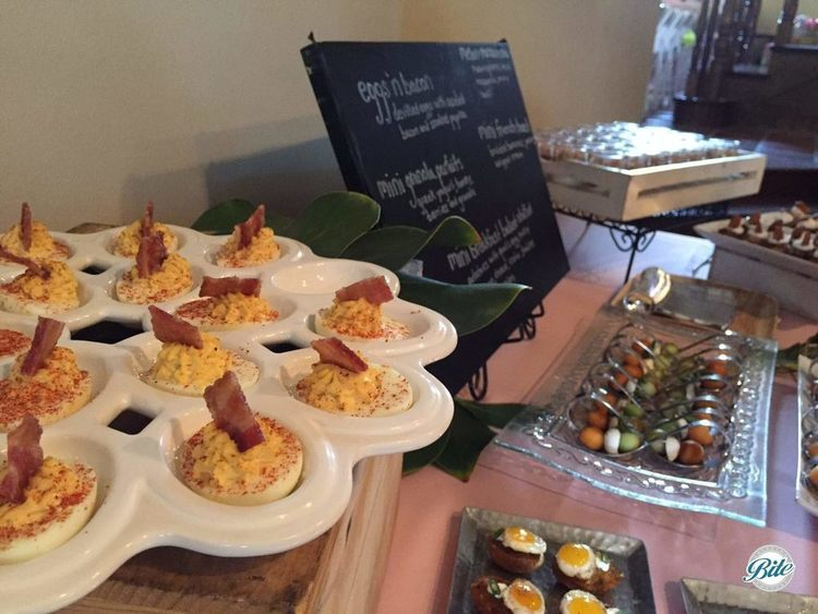 Deviled egg with candied bacon and smoked paprica