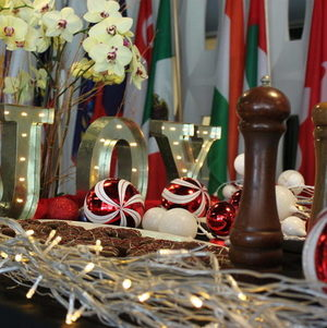 Closeup of Joy and Ornaments on Holiday Display