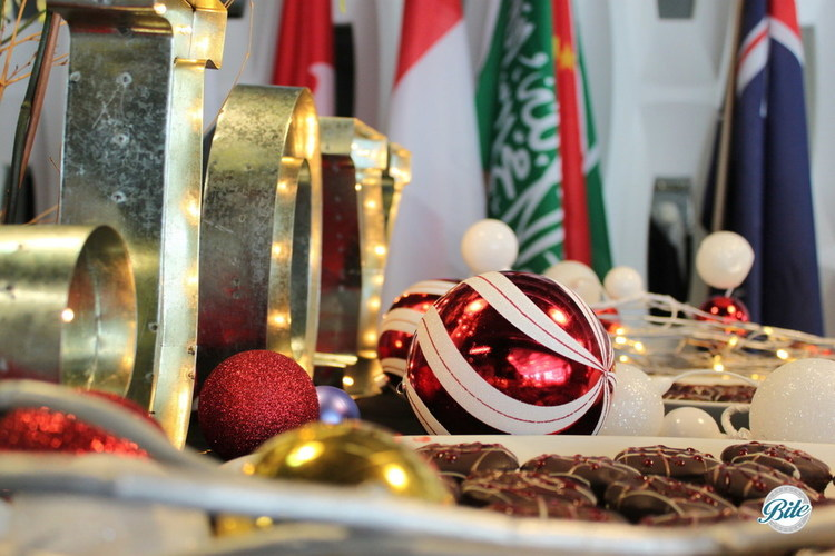 Desserts on holiday table with JOY and ornament