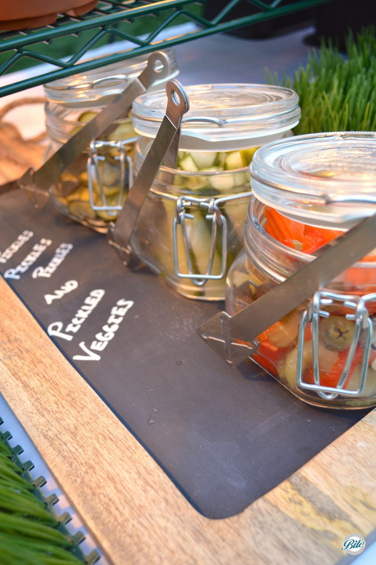 Slider bar condiments include pickles and pickled veggies