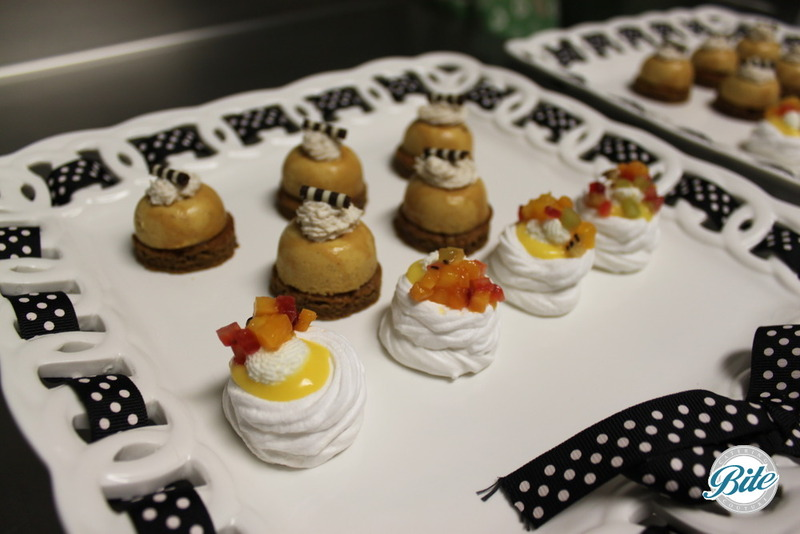 Seasonal dessert bites on white porcelain display pieces