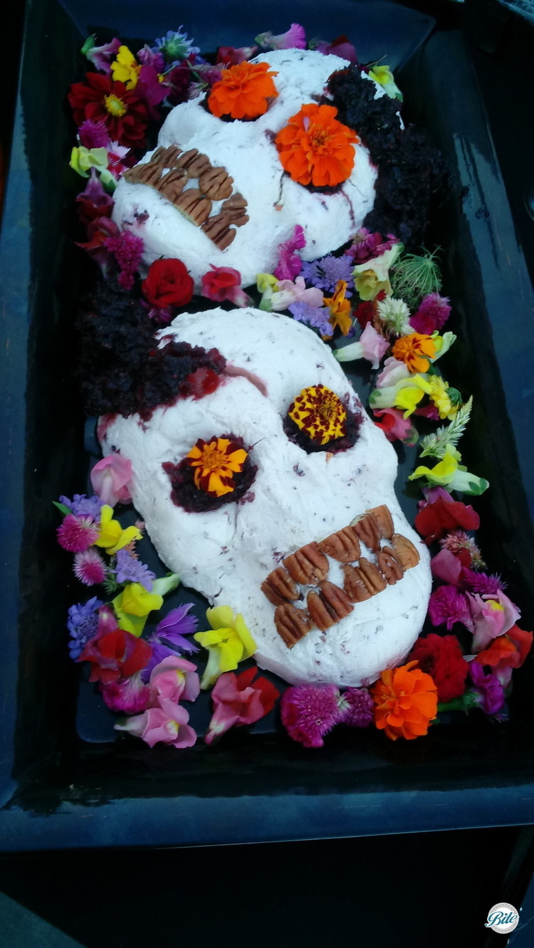 Cranberry-orange bleeding skulls with cranberry-orange compote with toasted pecan teeth.  Tray garnished with flowers...from 6 feet under