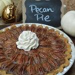 Pecan Pie Against Holiday Backdrop