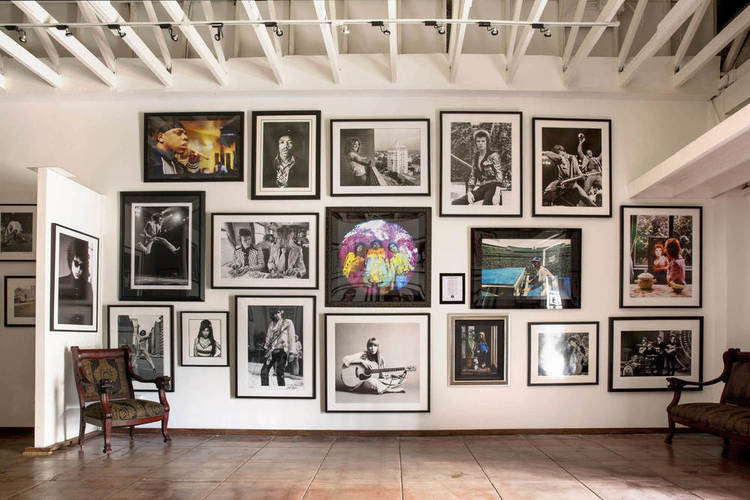 Portraits of musicians on the wall of the gallery at Mr Musichead