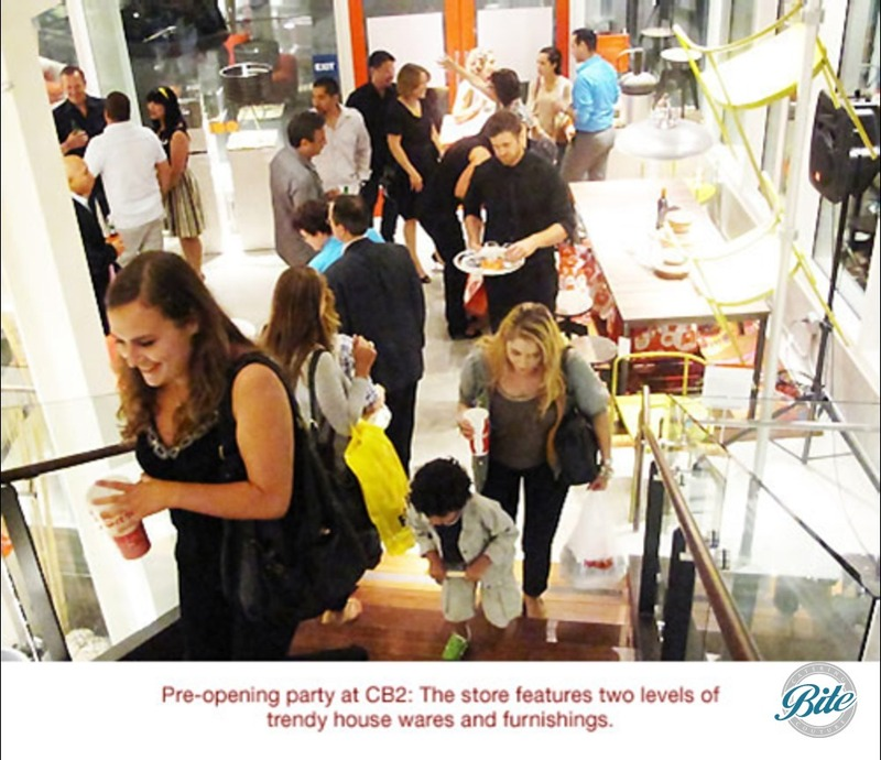 Grand opening at store where customers greeted with food and drink at the entrance