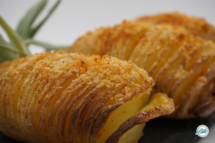 Parmesan panko dusted hasselback potatoes. Ready for toppings!  A hasselback potato is a baked potato with thin but joined slices baked until the outside gets super crispy while leaving a creamier consistency in the middle.