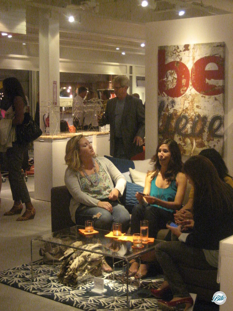 Guests enjoy drinks and company at store launch event